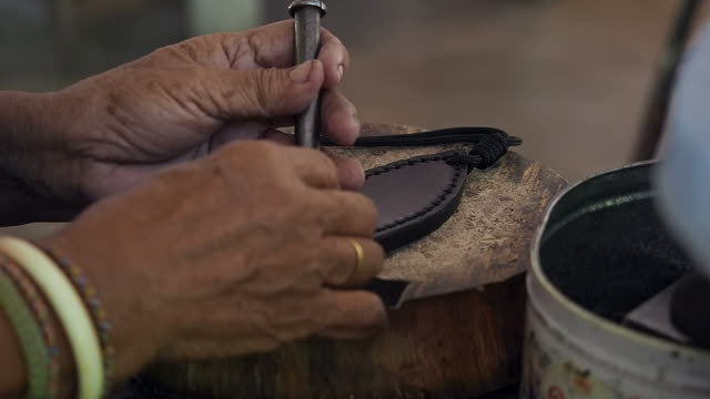 craftsman work in the leather workshop - artigiano video stock e b–roll