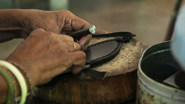 craftsman work in the leather workshop - malacca stock videos and b-roll footage