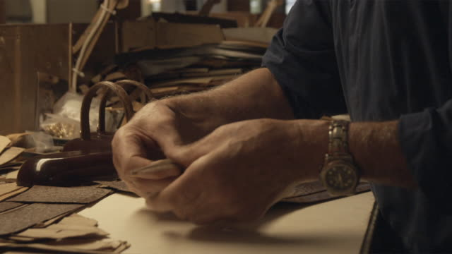 cu craftsman working on zipper / bologna, italy - tailor stock videos & royalty-free footage