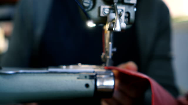 craftsman works in workshop - sewing machine stock videos & royalty-free footage