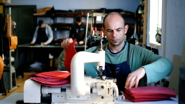 craftsman works in workshop - textile industry stock videos & royalty-free footage