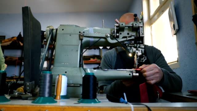 craftsman works in workshop - animal skin stock videos & royalty-free footage