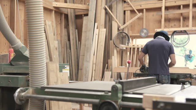 Craftsmen are cutting wood for making furniture