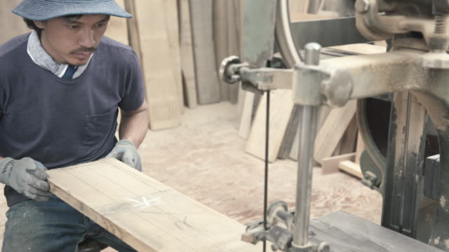 Craftsmen are cutting wood for making furniture