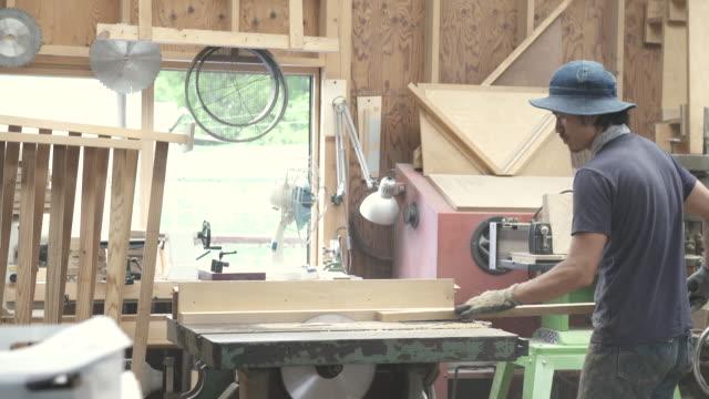 vídeos y material grabado en eventos de stock de craftsmen are cutting wood for making furniture - carpintería