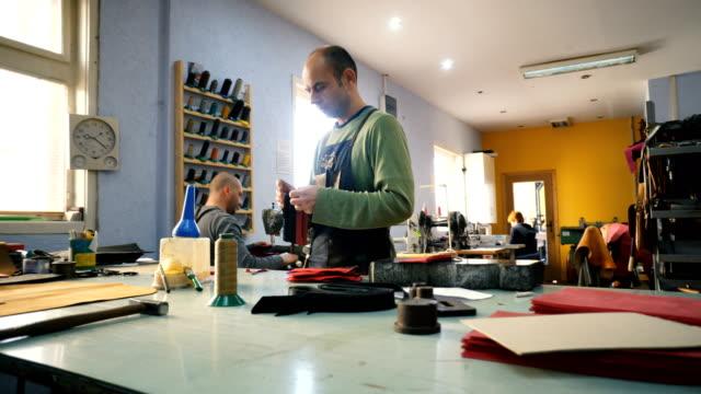 craftsmen work in workshop - craftsperson stock videos & royalty-free footage
