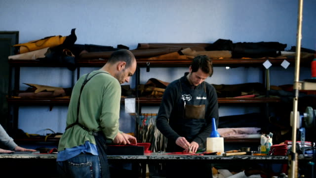 Craftsmen work in workshop