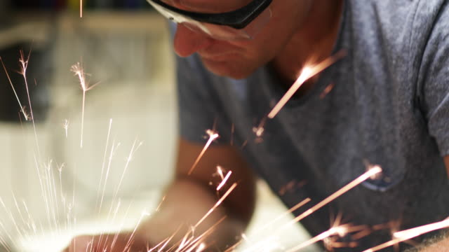 craftsperson welding in workshop - concentration stock videos & royalty-free footage