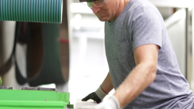 craftsperson working in snowboard workshop - only mature men stock videos & royalty-free footage
