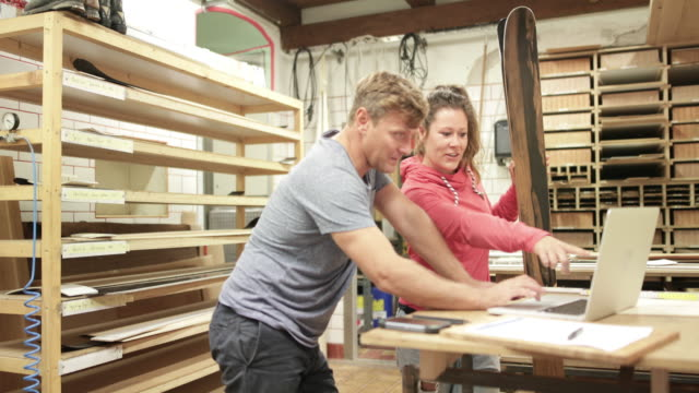 craftsperson working with trainee in snowboard workshop - north tirol stock videos & royalty-free footage
