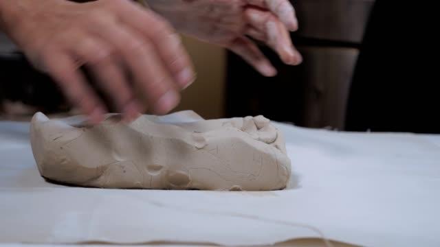 vídeos de stock e filmes b-roll de craftswoman creating handmade coloured tiles, the whole process, part of series - cão miniatura