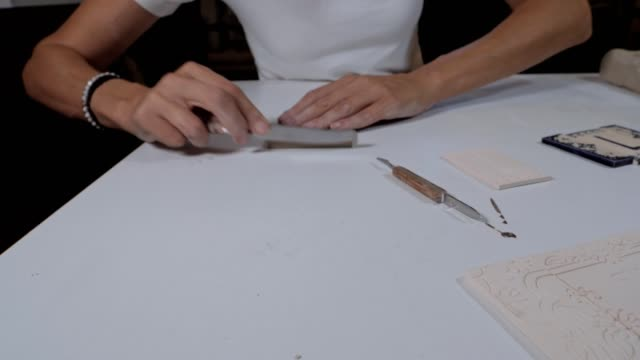 craftswoman creating handmade coloured tiles, the whole process, part of series - decorative art stock videos and b-roll footage