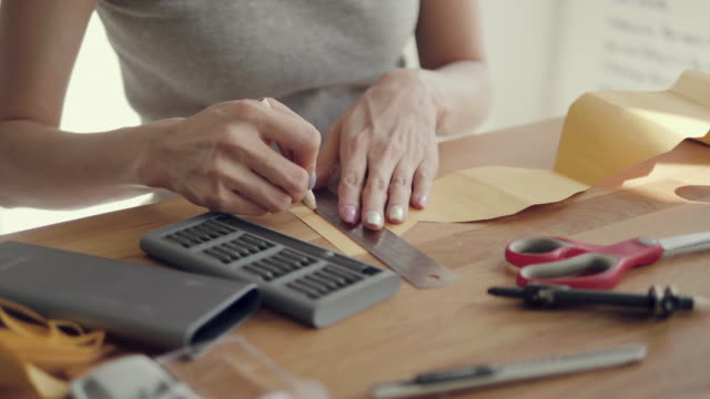Craftswoman working at desk in home