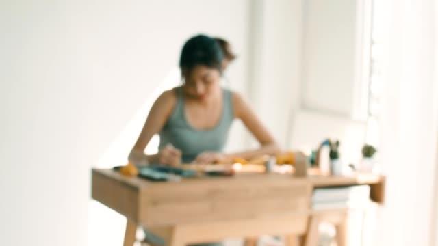 diy : craftswoman working at home - artigianato video stock e b–roll