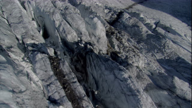 Craggy chunks of ice gather at the base of a glacier in the Austrian Alps. Available in HD.
