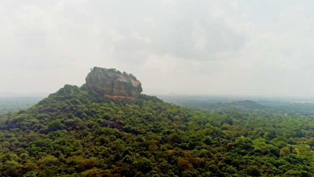 ws craggy rock hilltop surrounded by lush,green landscape,sri lanka - sri lanka stock videos & royalty-free footage