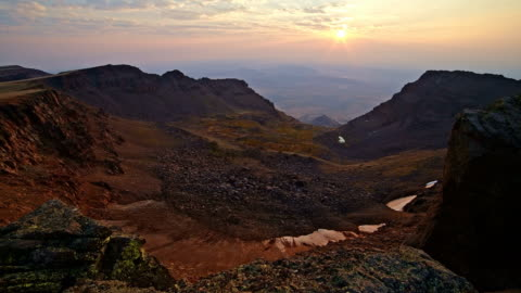 craggy rocks and glacier scoured canyon  with snow from desert summit of steens mountain in fall 2 - oregon us state stock videos & royalty-free footage