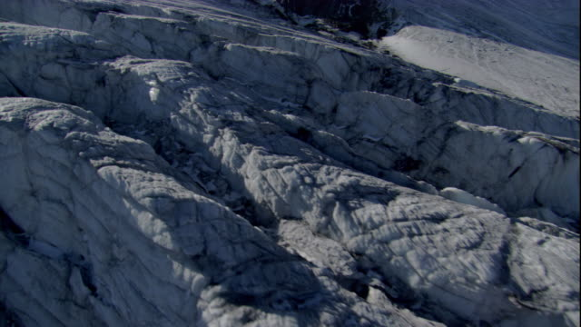 Craggy, tumbled ice collects at the edge of a glacier in the Austrian Alps. Available in HD.