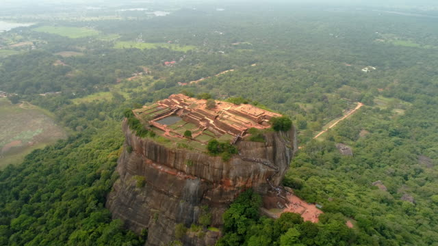 ws craggy,rock formation towering over lush green landscape,sri lanka, sigiriya - nature reserve stock videos & royalty-free footage