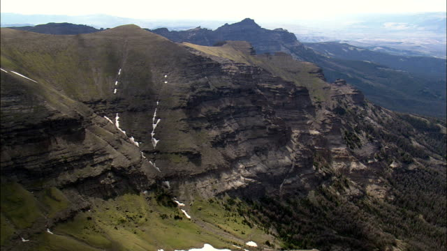 crags in teton national forest - aerial view - wyoming,  fremont county,  helicopter filming,  aerial video,  cineflex,  establishing shot,  united states - rock face stock videos and b-roll footage