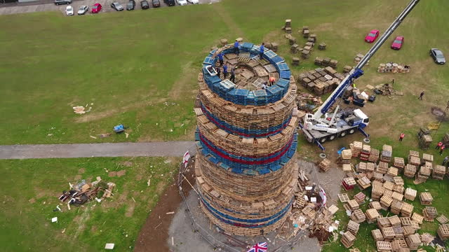 craigyhill bonfire being built in larne, northern ireland for the annual 12th july celebrations, a loyalist tradition to celebrate a protestant... - tradition stock videos & royalty-free footage