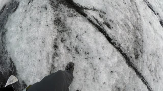 crampons grip glacier in iceland - walking point of view stock videos & royalty-free footage
