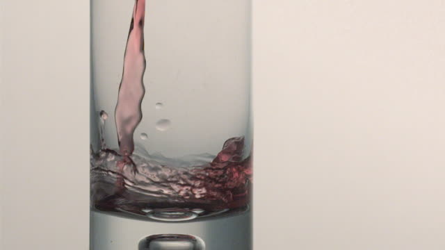 cu slo mo cranberry juice being poured into glass / san francisco, california, usa   - cranberry stock videos & royalty-free footage