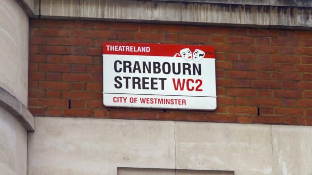 cranbourn street sign in london's west end - road sign stock videos & royalty-free footage