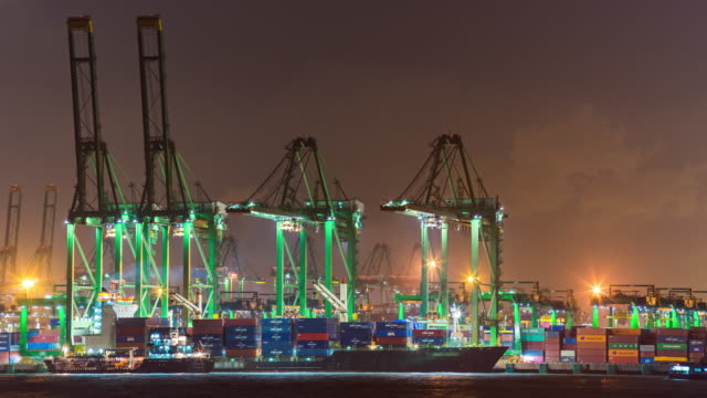 crane and container ship in industrial port at night, singapore, night time lapse video - passenger ship stock videos & royalty-free footage