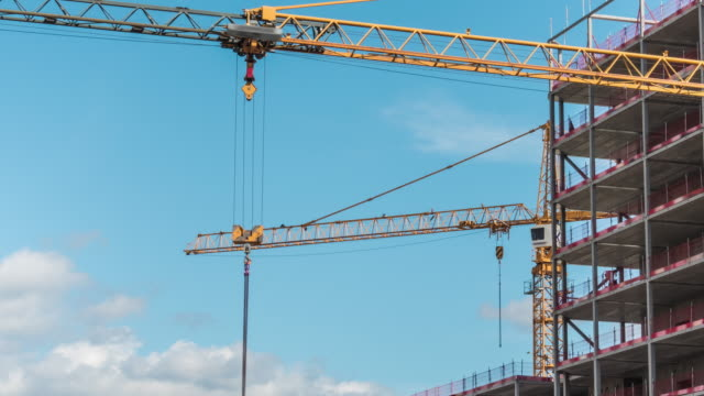 crane at construction site time lapse - crane stock videos & royalty-free footage