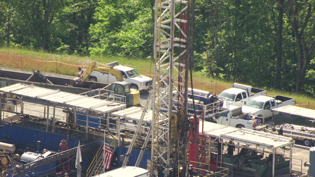 ms tu aerial crane at work base for chesapeak energy gas pipeline in wetzel county / littleton, west virginia, united states - pipeline stock-videos und b-roll-filmmaterial