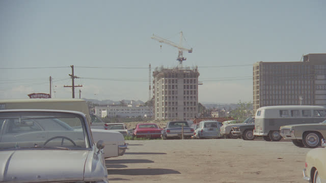 crane atop building under construction in bunker hill area of los angeles - 桁橋点の映像素材/bロール