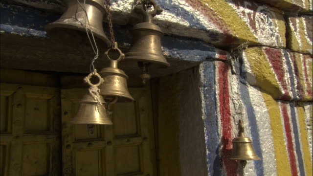 Crane down from bells to doors of Tungnath temple, India Available in HD.