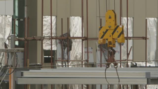 crane hoist and building framework - hoisting stock videos & royalty-free footage