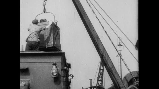 montage crane hoisting box of coal onto train / scotland,united kingdom - transport conductor stock videos & royalty-free footage