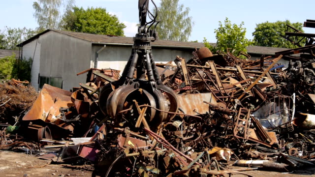 crane in a junkyard. - claw stock videos and b-roll footage