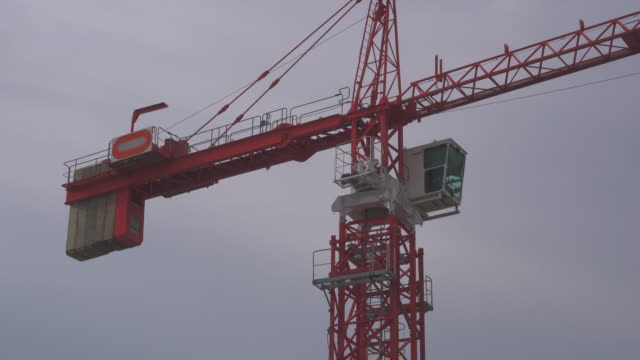crane in construction site,tilt up - tilt up stock videos & royalty-free footage