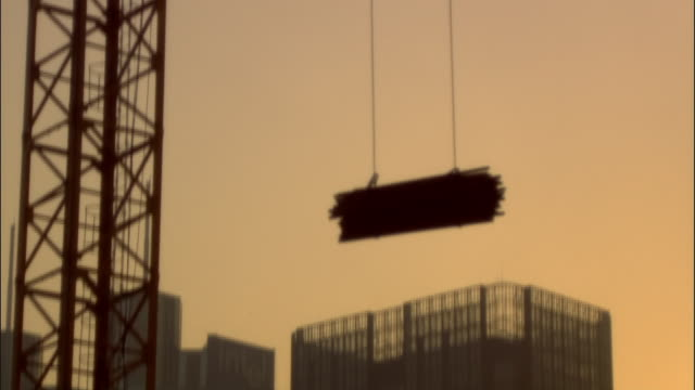 ms, tu, crane lifting bundle of iron pipes on construction site, beijing, china - bundle stock videos & royalty-free footage