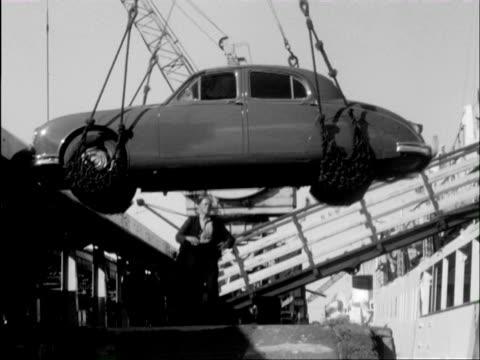 stockvideo's en b-roll-footage met ms crane lifting car on ship and view of train / fishguard harbour, pembrokeshire, wales - pembrokeshire