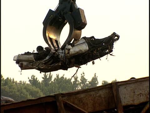 CU, Crane lifting junk car over conveyor belt, Capitol Heights, Maryland, USA