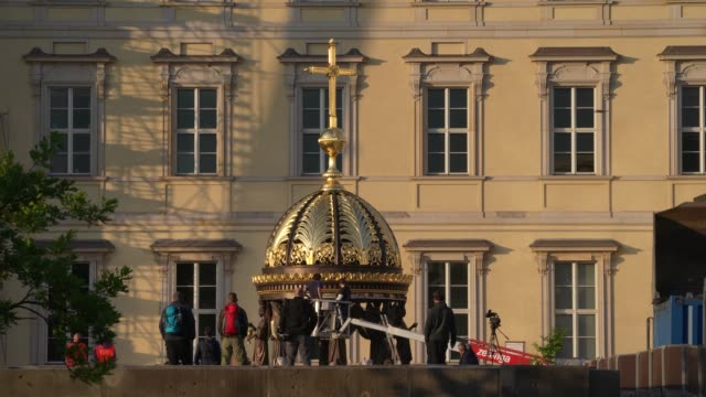 DEU: Berlin City Palace Receives Its Golden Cupola And Cross