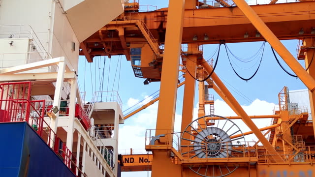 crane loading cargo container box from ship - crate stock videos & royalty-free footage