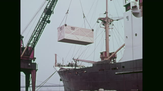 ms tu crane loading container branded 'made in the usa  into freight ship / united states - 1960 stock videos & royalty-free footage