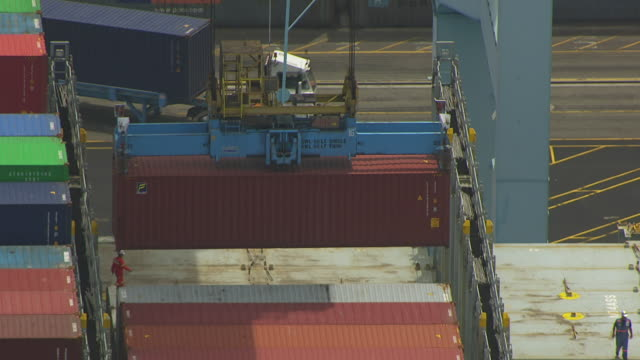 ws tu td aerial pov crane loading containers in freight ship / long beach, california, united states  - crane stock videos & royalty-free footage