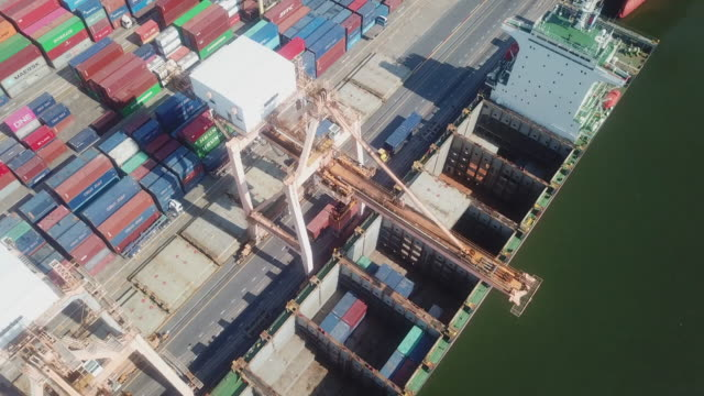 crane loading containers in import export - chain store stock videos & royalty-free footage