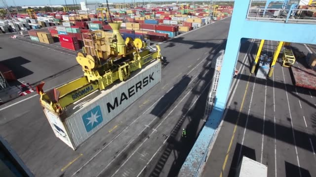 a crane loads a shipping container from ap mollermaersk a/s onto the freight ship the nele maersk operated by ap mollermaersk a/s at the seayard co... - port authority stock videos & royalty-free footage