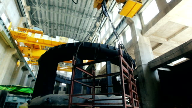 Crane lowering a metal cage