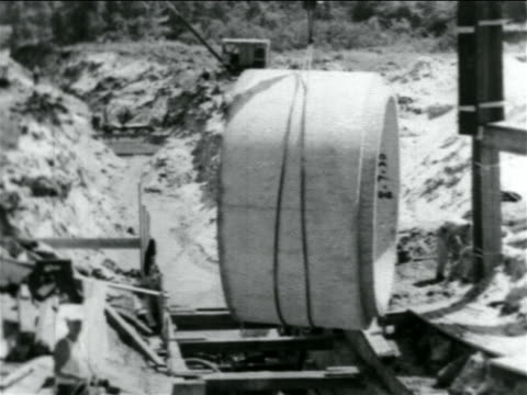 b/w 1934 crane lowering cement pipe piece in wpa sewage construction project / documentary - sewage treatment plant stock videos & royalty-free footage