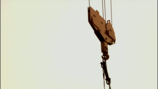 CU, TD, Crane lowering metal girder on construction site, Beijing, China