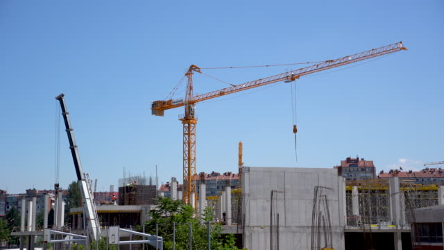 crane moving at the site - picking up stock videos & royalty-free footage